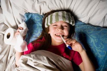 A little girl feigns illness.