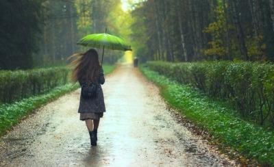 A woman takes a walk despite the rain.