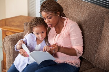 A mother reads aloud to her child.