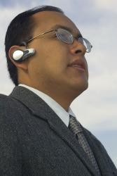 A man using a Bluetooth headset.