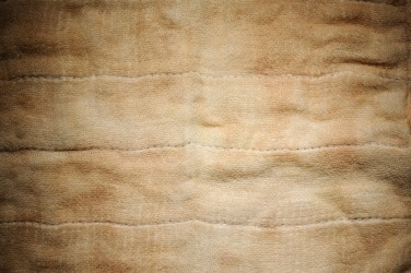 A piece of fabric showing discoloration.