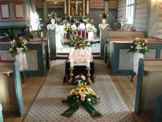 A coffin in a church ready for a funeral.