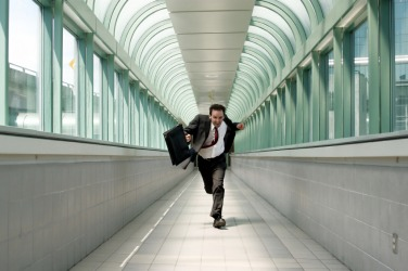 A man hurries down a corridor.