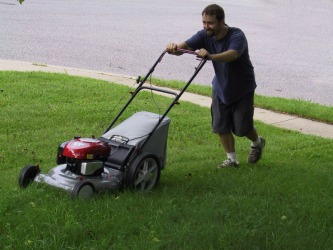A man mows his yard.