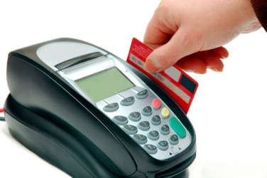 A credit card is being used to make a payment.