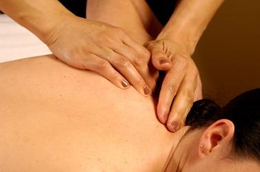 A woman gets a back rub.
