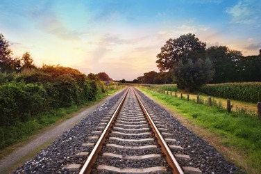 A straight stretch of railroad track.