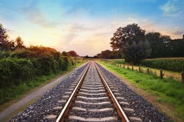 A straight stretch of railroad track.