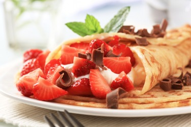 Crepes served with strawberries.