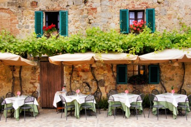 Outdoor seating at a trattoria.