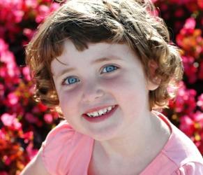 A big pretty smile on a pretty little girl.