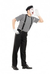 A pantomime making a gesture.