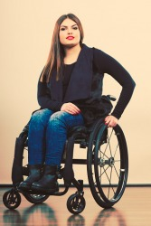 A woman who uses a wheelchair.
