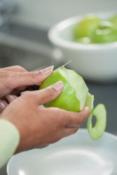 She pares the apples for her homemade apple pie recipe.
