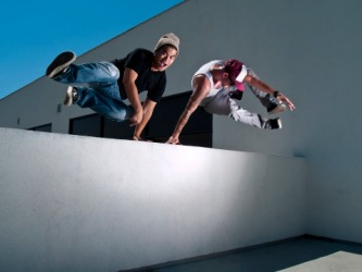 Young men practicing the sport of parkour.
