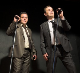 Two men performing a parody of the Blues Brothers on stage.