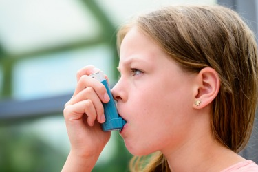 The young girl's occasional paroxysm due to her asthma is easily treated with an inhaler.