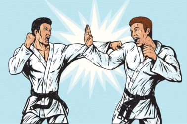 An opponent put up his hand to parry the karate punch.