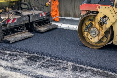 A road being paved with asphalt.