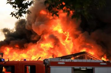 The blaze of a housefire.