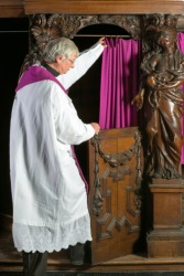 A priest entering a confessional so that he can advise sinners of their penance.