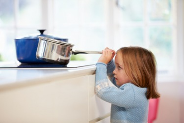 Amber was in a perilous situation when she tried to take a pot off of the stove.
