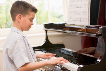 Tyler perseveres with his piano lessons because he wants to do well in the recital performance.