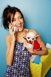 A petite woman shopping with her petite dog.