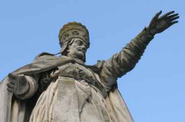 Statue of a pope holding out his hand as if to bless.