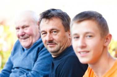 The physical heritage of having the same forehead and hairline is shared by the grandfather, father and son.
