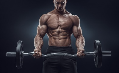 The body builder's physicality implied that he spend many hours at the gym.