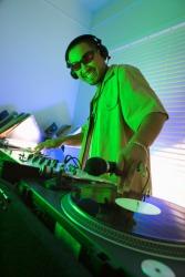 A DJ pivoting a record to make music.