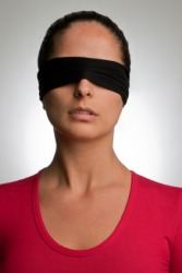 A woman wearing a blindfold.