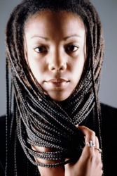 A woman with long plaits.