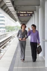 Women walking on a train platform.