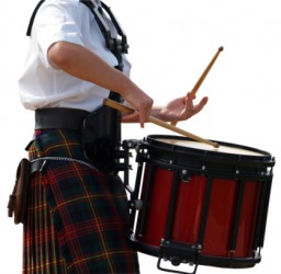 A man wearing a pleated kilt.