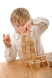A child playing with wooden blocks.
