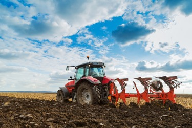 A tractor ploughing a field.
