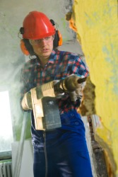 A man using a pneumatic drill