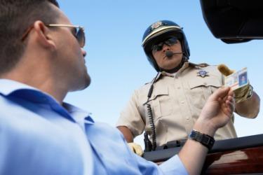 A policeman checking man's identification.