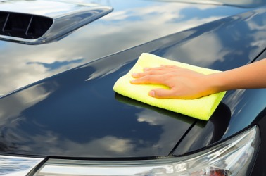 Polishing a car with a soft cloth.
