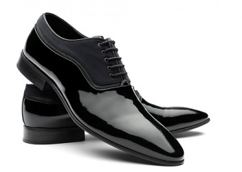 A pair of black shoes polished to high shine.