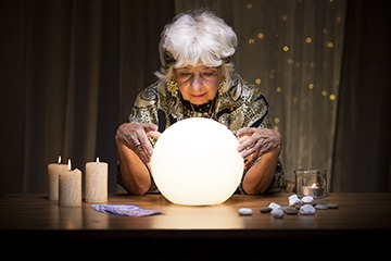 A psychic peers into her crystal ball and gives me a favorable prediction about my future.