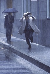 He would preferably be protected from the rain with an umbrella rather than a newspaper.