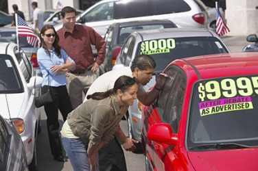 A family checking the price of a used car.