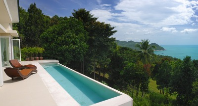 A secluded pool balcony overlooking the ocean offers gorgeous views and privacy.