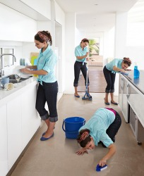 The process of cleaning a kitchen.