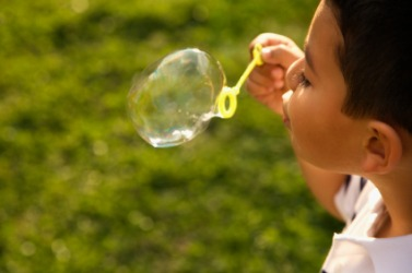 A child blowing a bubble.
