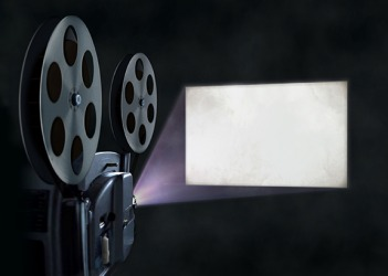 The light from the film projector projects onto the screen.