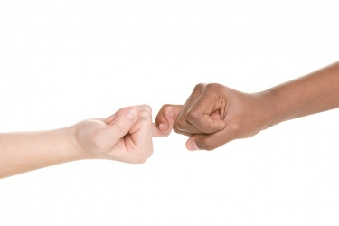 Two children making a pinky swear promise.